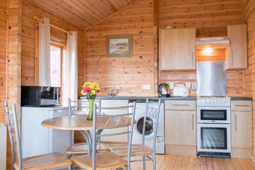 Open plan living area in Fors Lodge - kitchen and dining area