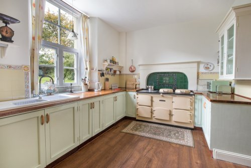 Large fitted kitchen with Aga