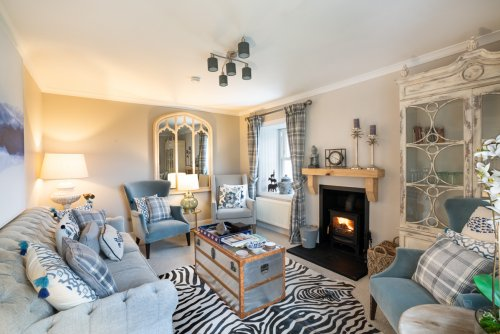 Light the wood burning stove and relax in the beautifully presented living room