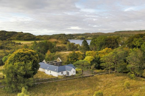 Burn Cottage and its setting by Loch Cuin