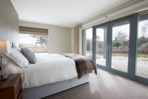 Master double bedroom with double doors to the garden
