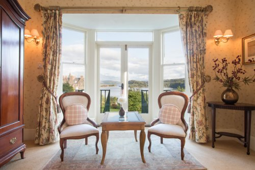French doors in the master bedroom with stunning views of the harbour and Morven beyond