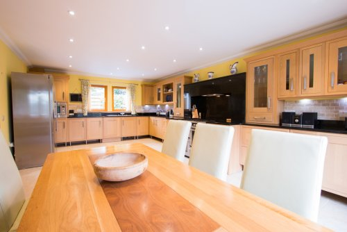 Modern fitted kitchen with breakfast/dining table