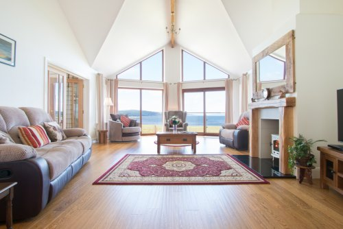 Living room with open views to the sea across the airfield