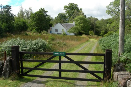 Gate and drive leading to cottage
