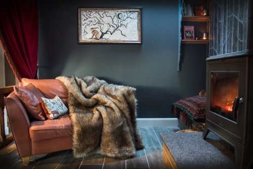 Fur throws and wood burning stove make this a romantic retreat
