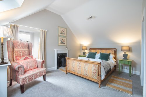 Each bedroom is beautifully furnished with a modern meets antique feel