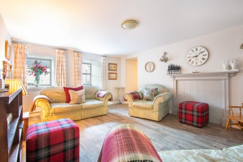 Relax in the sitting room at the Old Byre