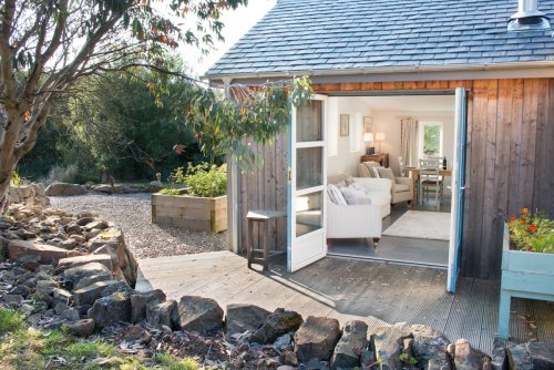 Bring the garden in with patio doors that lead onto a charming deck