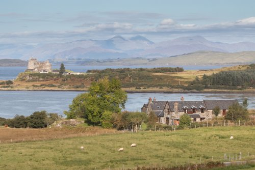 The buildings at Kilpatrick with Duart Castle in the distance