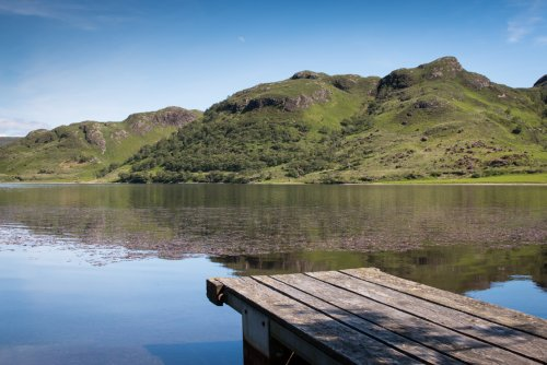 Pier on Loch Uisg - Fishing boats can be hired locally subject to availability